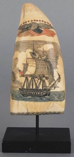 Scrimshaw; An early to mid 19th century New England scrimshaw [and polychromed] whale's tooth the front decorated with a sailing ship flying an American flag, surmounted by an eagle holding an American flag under a row of thirteen stars, the reverse depicting an oval portrait of Grace Darling amidst timbers, lines, and a distraught sailor pining over her, with sheet music and a floral band