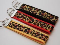 Hunger Games Inspired Mockingjay Keychain Wristlet You Pick. $6.00 each. Find Bonzai Gifts on Facebook for more!