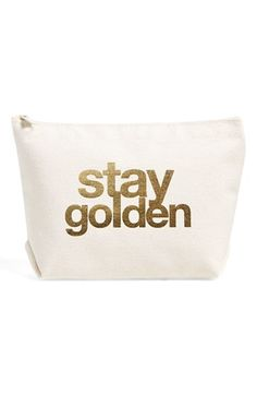 A metallic foil message makes a playful statement on a sturdy canvas zip pouch perfect for carrying all your essentials.