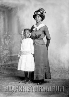 Mom & Me | 1914    Studio portrait of African American woman with her daughter by her side. Rufus Holsinger, photographer. 1914. Holsinger Studio Collection, University of Virginia.
