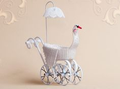 WC/011, wicker, swan child's carriage, scale 1 : 12, made by Will Werson.