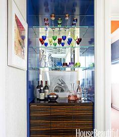 Amanda Nesbit Decorates With Blue - Walls lacquered in Benjamin Moore's Aura in Midnight Navy embellish a tiny hallway bar.