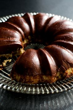"NYT Cooking: In this magical recipe by Ben Mims from his cookbook ""Sweet & Southern,"" vanilla cake and chocolate custard are layered into a Bundt pan before baking. In the oven, the two switch places, with the heavier custard sinking while the cake rises to the surface. Once unmolded, you end up with a tender band of cake on the bottom and creamy, wobbly flan on top. It�s rich, soft, deeply fudgy and a hit at dinner parties."