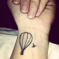 My first tattoo of a hot air balloon and a swallow #tattoo #balloons #swallow - small, elegant line drawing style.