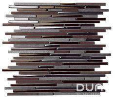 Mosaico de piedra y cristal de tonos marrón e iridiscentes. http://www.dune.es/es/products/emphasis-mosaico/materia-mezcla-de-materiales/pluton/186728