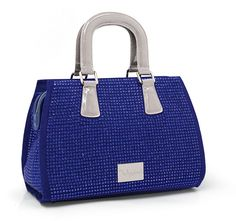 """The outside of this handbag is made of blue genuine suede leather and grade """"A"""" sapphire crystals.  Silver hardware adorn this handbag.  This inside is made of high end turquoise blue satin fabric."""