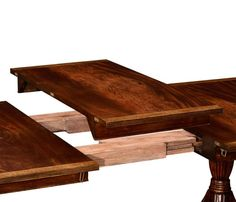 Dining table with wood slides and a drop in leaf