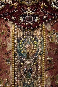 This particular image highlights the highly decorative and embroidery style of the Elizabethan times.