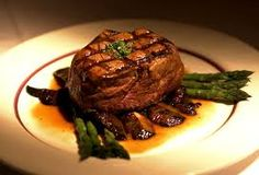 steak with a beef gravy and an asparagus bedding Chef Recipes, Great Recipes, Homemade Corned Beef, Steak Dishes, Miami Restaurants, Aged Beef, Asparagus And Mushrooms, Nigerian Food, Star Food