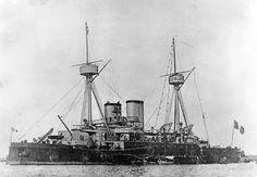 Indomptable (French Battleship, 1883). In harbor circa the 1880s, showing her original main battery of two 16.5-inch guns, one at each end of the superstructure. The original print is in an Office of Naval Intelligence album of French warship photographs. Courtesy of the Naval Historical Foundation, Washington, D.C. U.S. Naval History and Heritage Command Photograph.