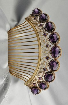 Antique Amethyst Tiara, set with nine cushion-cut amethysts graduating in size, framed by burr motifs, with circular-cut amethyst accents, within an elaborate scrolling 14kt gold mount, removable brass teeth for comb conversion.