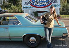 '64 Oldsmobile at the track with it's female driver.