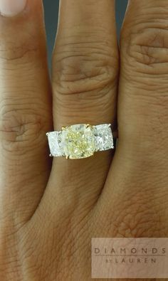 Love the idea of a lightly colored yellow diamond in the middle of a ring