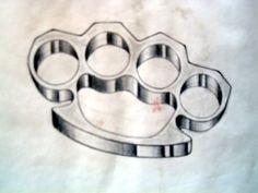 Brass Knuckles Tattoo