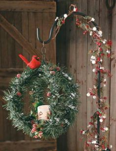A great alternative to putting a wreath on the door .. Get a wreath hanger & hang your Holliday Wreath...