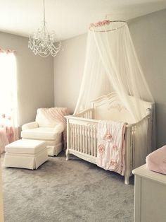 Girly pink blush nursery with chandelier, ivory rocker and glider ottoman, and ivory crib canopy. My dream nursery! Baby Boy Cribs, Baby Boy Bedding, Baby Bedroom, Baby Room Decor, Nursery Room, Nursery Decor, Blush Nursery, Room Baby, Floral Nursery