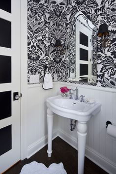 Damask wallpaper ~ Love the way the door is detailed and the glass doorknob - Martha O'Hara Interiors