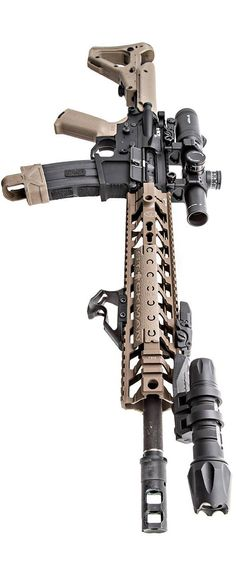 1-4 Vortex Optics up top, with a Fortis rail and handstop. The billet ambi lower is Mega Arms, and the light is Elzetta Design. The upper is a BCM with SureFire MB556K brake. Photo by Stickman.