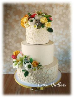 loads of gumpaste flowers on middle tier of wedding cake - Google Search