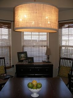 Drum Pendant Light Tutorial.  This is a cool way to update a boring light fixture in a dining room (or wherever!)  She used burlap to cover, but the possibilities are endless here - thekeylorfamily.blogspot.com