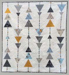Triangle quilt. Made with blocks in rows, then sewn together. A simple design creates a timeless quilt.