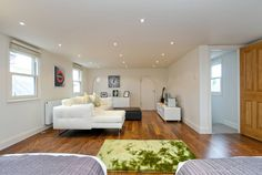 Modern living area transformation : Modern bedroom by A1 Lofts and Extension