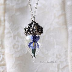 Purple Iris Flower Glass Vial Terrarium Necklace by Woodland Belle ($160) ❤ liked on Polyvore featuring jewelry, necklaces, purple necklace, flower jewellery, iris jewelry, blossom jewelry and flower jewelry