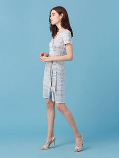 Airy and ideal for warm weather, this wrap style dress is cut in a lightweight silk jersey, with short sleeves and a mid-thigh, flirty cut.
