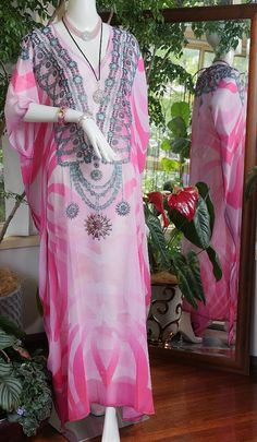 Fab crystal embellished Kaftans 50% off    Long Kaftans with fab crystal embellishment on sale now. One size fits most. Can be let out easily as there is a generous side allowance. 148cm in length    DON'T MISS OUT ... LIMITED AVAILABILITY    #blackfriday #cybermonday #bling #kaftans #beach #cruising #summer #christmas #instagift #holiday#gift    ACCESSORIES NOT INCLUDED. Can be purchased by emailing sales@glamystique.com for details | Shop this product here…