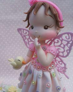 Mini topo de bolo personalizado com vela luxo, vários temas, feito por encomenda.  Medidas aproximadas: Altura 12 cm, a bonequinha mede em média 10 cm. Comprimento da base 14 cm.