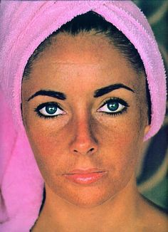 The famous photo of Elizabeth Taylor without any make up taken by Roddy McDowall in 1964; he tried to recapture the same photo 30 years later, in 1992. Unless I'm blind, there is make up on her eyes...