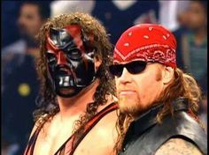 Big Red Machine Kane with his 'brother' The Undertaker