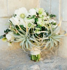 Anemone bouquet with gold-tipped air plants for a desert bohemian wedding