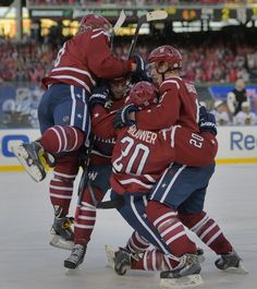 WASHINGTON DC, JANUARY 31: Washington right wing Troy Brouwer (20), center, is mobbed by his teammates after scoring the game winning goal in the fina...