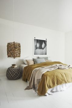 Bed is the center of this chic minimalistic bedroom