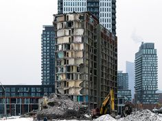 20150208. New and old contrast vividly in Toronto's Regent Park during the demolition of its 2nd last modernist tower.
