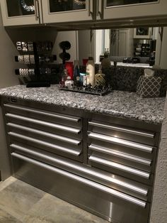 My locking jewelry toolbox with a granite top, mirrored wall space and glass display cabinets above.