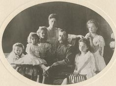 The whole imperial family poses very formally in 1906. You can see Tatiana on the right, next to her father.