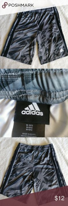 Adidas Athletic Shorts Boys Large 10-12, athletic shorts. Elastic waistband, adjustable. Pockets on the sides. Black and gray pattern. In really good condition. adidas Bottoms Shorts