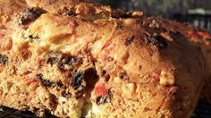 This is a Swedish cardamom bread adorned with candied cherries, citron and golden raisins.