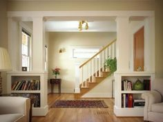 Half Wall Room Divider Idea With Large Built In Wooden Design And Has Bookshelf For Modern Living