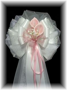pink tulle bows for weddings | Pearl-Beaded Foam Calla Lily Pew Bows in Shades of Pink to Purple