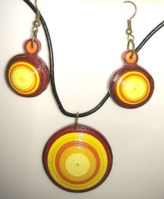 quilled set with spherical earrings and 3d pendant. varnished.