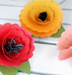 Cut, fold and glue your way to colorful paper flowers in no time! Use for decorating or homemade gifts. - Everyday Dishes & DIY