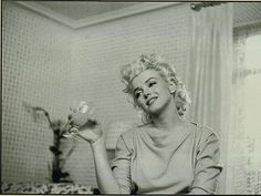 My 2 favorite. Wine and Marilyn!  LOVE IT!  what id give to have Ms. Marilyn as part of our wine night. :)