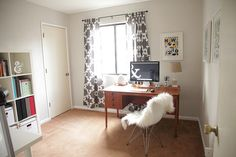 Pretty office.  Gorgeous curtains and desk. Love how bright it is.