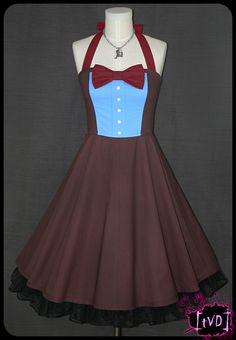 Wibbly-Wobbly Timey-Wimey! Bodice Style dress made from 100% Cotton fabric panels, topped off with bias binding along the bottom hem, a row of buttons over the bust, a large bow-tie and X-long suspender-like halter straps.