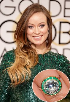 Olivia Wilde ... Bringing out the colour in her eyes, Olivia Wilde's engagement ring picked out by her funnyman love Jason Sudeikis was the perfect choice. The ring features a central diamond surrounded by a halo of tiny emeralds, which catch the light as Olivia moves her hand.