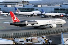 Boeing 777-3F2/ER Aircraft with the TA (Turkish Airlines) Emblem.