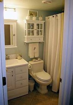 small bathroom decorating ideas i would want to add two towel hooks on the oposite wall to hand our towels and put a shelf of extra towels above those